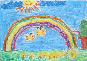 Rysunek wykonany kredkami świecowymi.Na rysunku widać tęczę, ugóry rysunku jest uśmiechnięte słońce natle nieba, podtęczą motyle ikwiaty.
